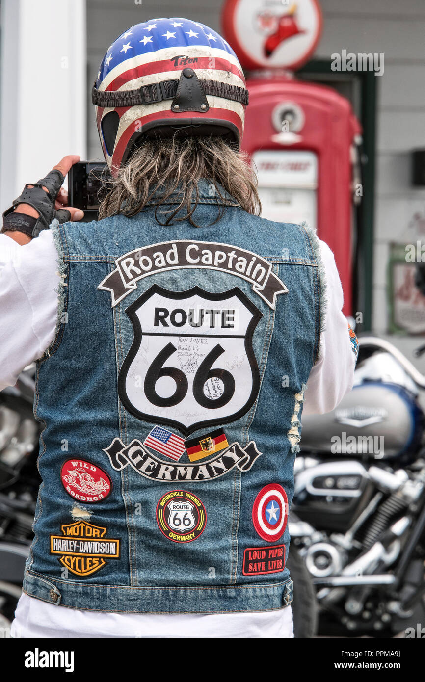 Harley Davidson biker with Route 66 jacket and Stars and Stripes helmet, Dwight, Illinois. - Stock Image