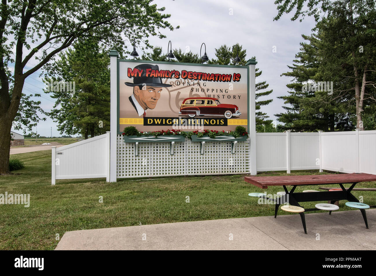 Old advertising billboard at rest stop in front of historic gas