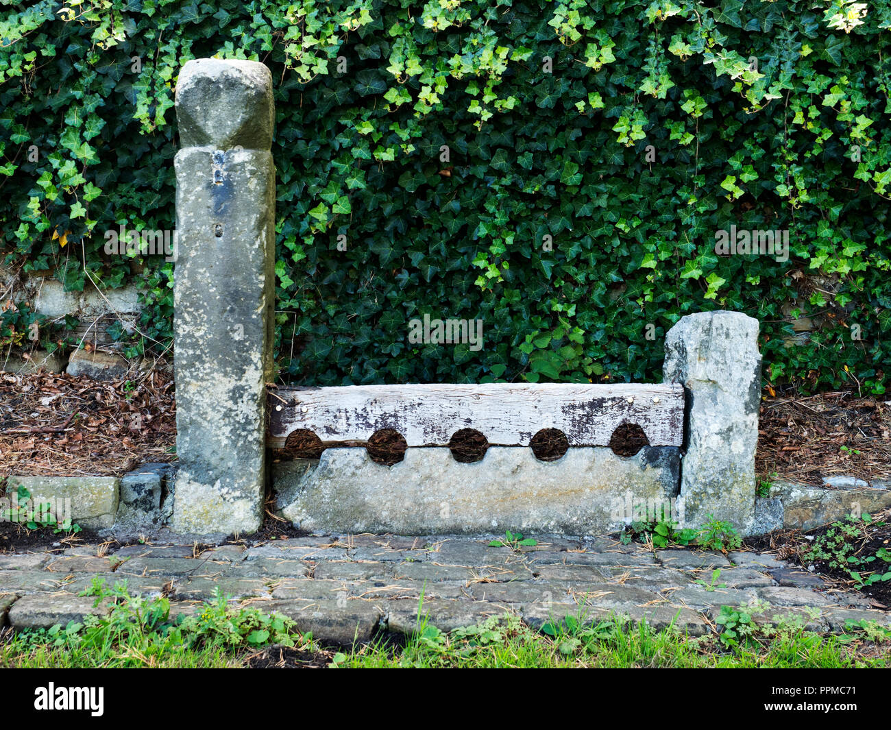Old Stocks in the village of Leathley in the Washburn Valley North Yorkshire England Stock Photo