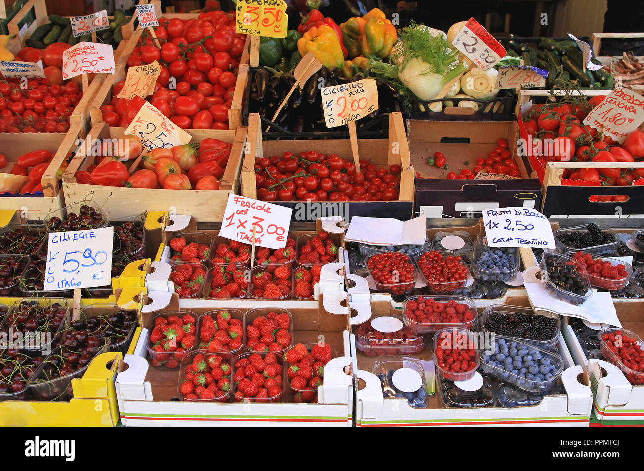 All kind of berry fruits at farmers market stall - Stock Image