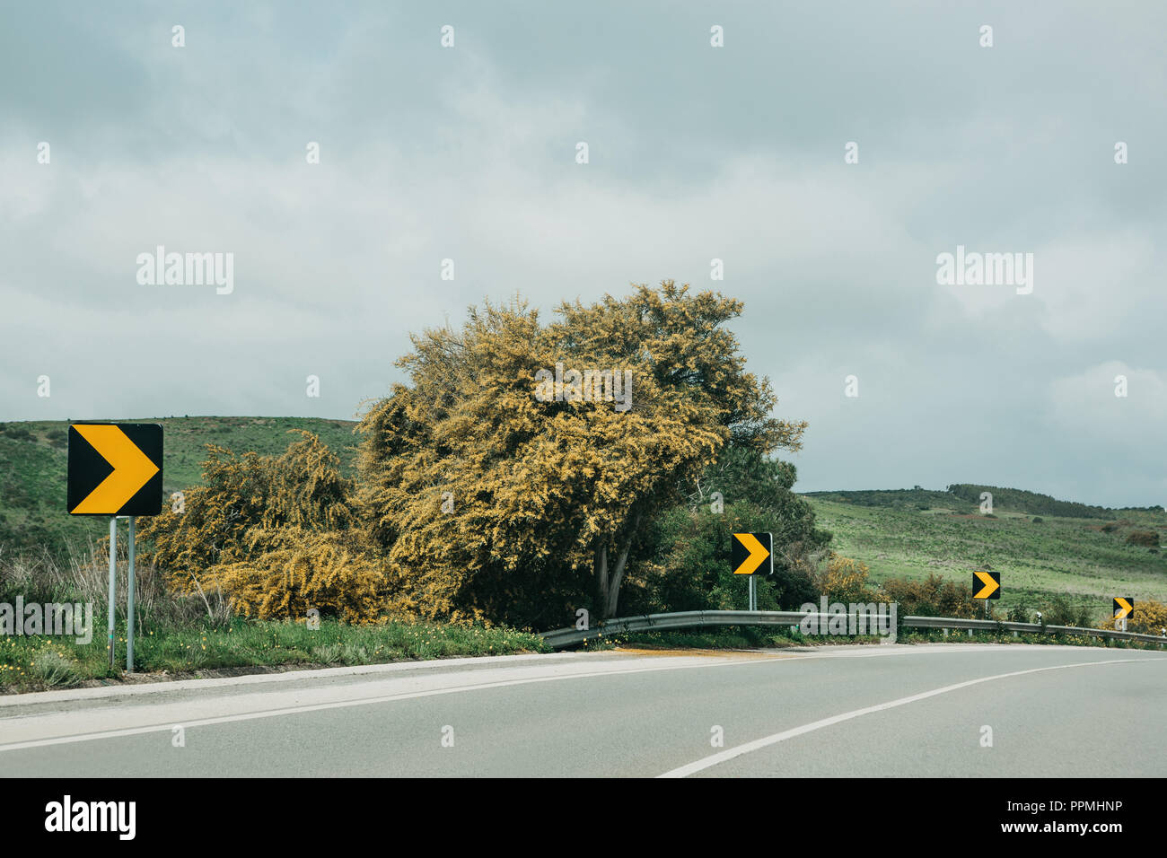 Reflective direction indicators on the road. Warning for drivers. - Stock Image