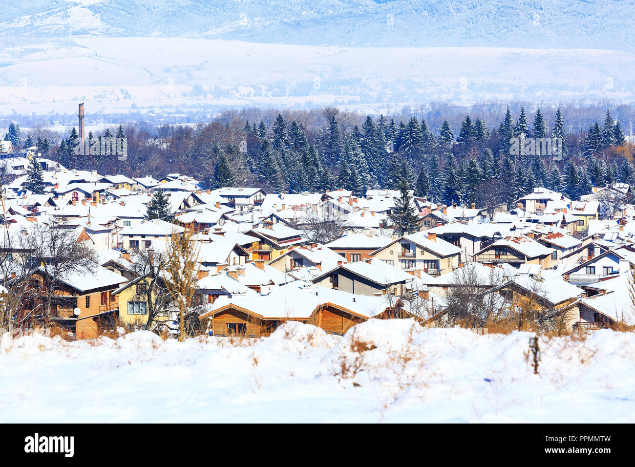 Houses with snow roofs panorama banner of bulgarian ski resort Bansko, Bulgaria - Stock Image