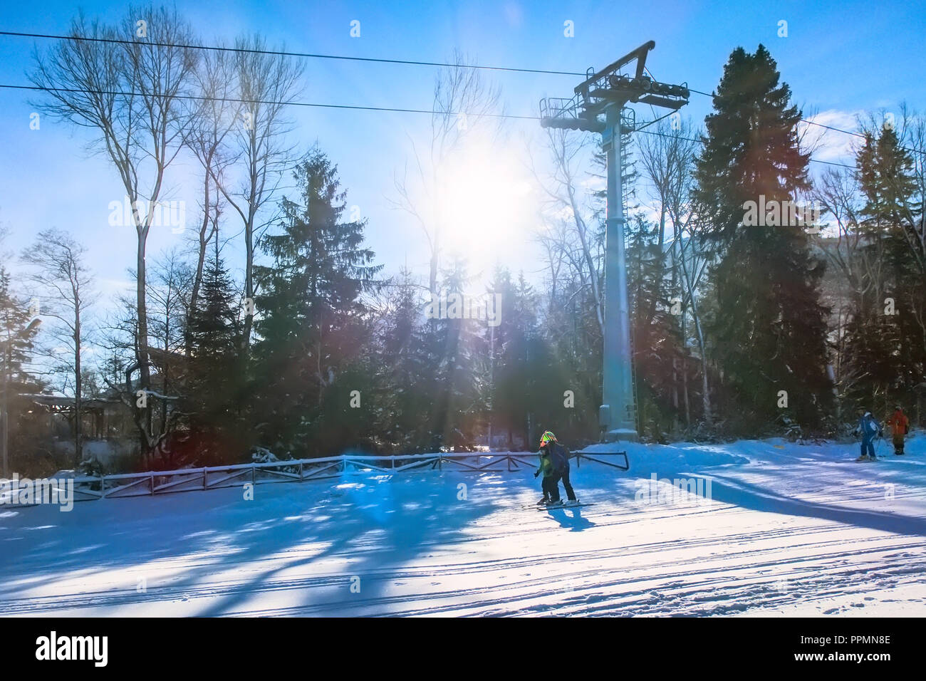 ski resort panorama with ski lift cabin, slope and snow mountains, Bulgaria - Stock Image