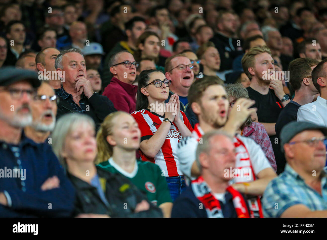 London, UK. 26th September, 2018. Carabao EFL Cup, Third round, Arsenal v Brentford ; Brentford fans react at the Emirates.  Credit:  Georgie Kerr/News Images  English Football League images are subject to DataCo Licence Credit: News Images /Alamy Live News Stock Photo