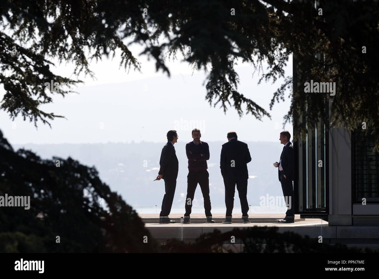 27 September 2018, Switzerland, Nyon: Four men in dark suits