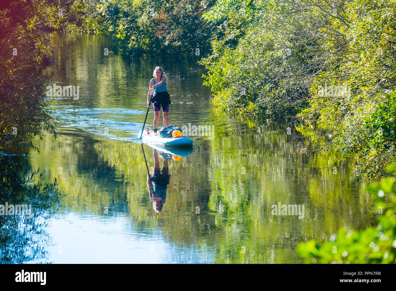 Aberystwyth Wales UK, Thursday 27 September 2018  UK Weather:  Environmental campaigner GILLY THOMAS out on her paddleboard,  voluntarily patrolling the River Rheidol in Aberystwyth, looking out for and collecting pplastic rubbish,  on a  sunny and warm 'Indian summer' morning in Aberystwyth , as the UK heads into a period of settled warm sunny weather. Photo © Keith Morris / Alamy Live News - Stock Image