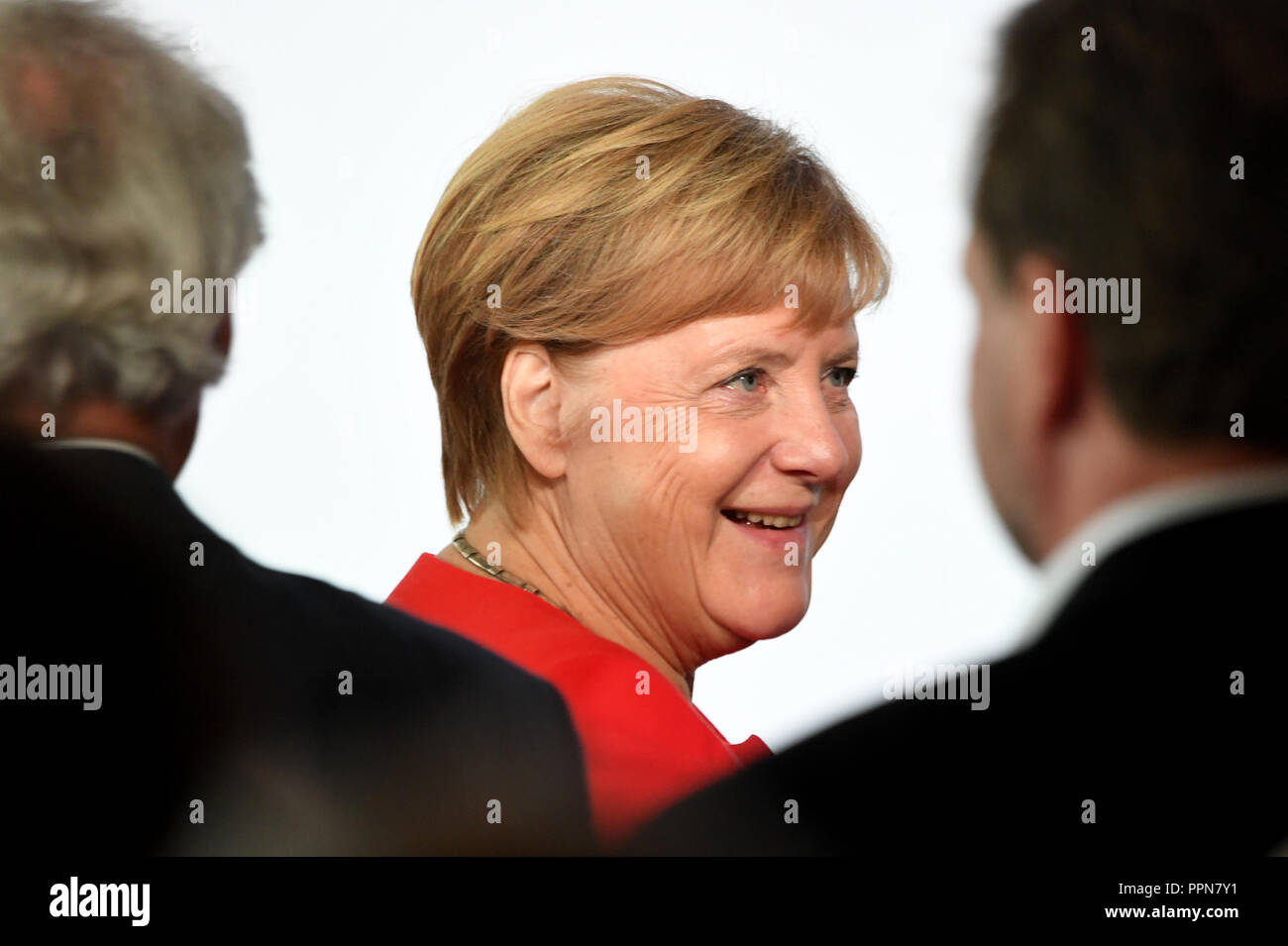 006c1add3009 27 September 2018, Berlin: Chancellor Angela Merkel (CDU) comes to the  symposium