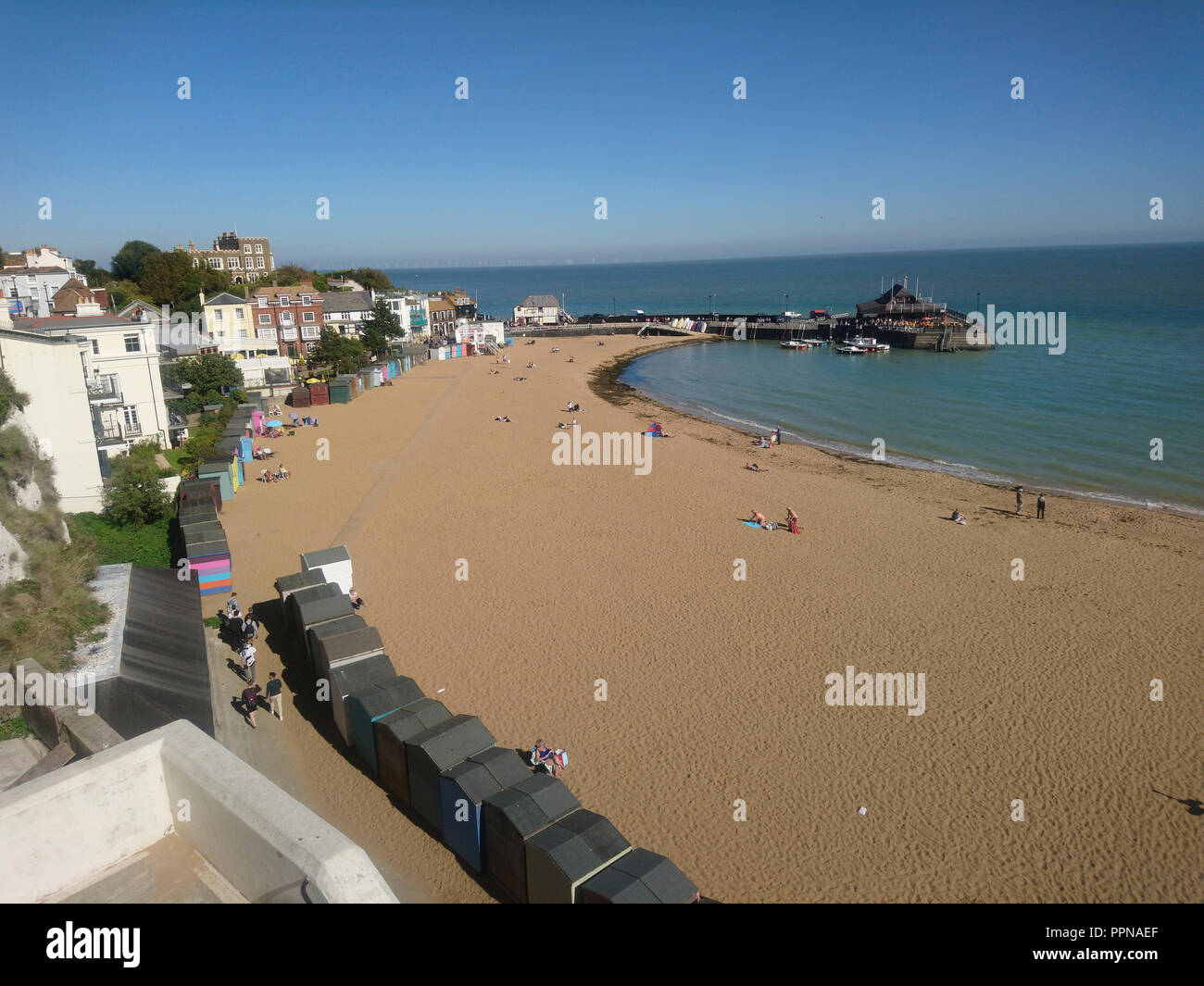 Broadstairs, Kent. 27th Sept 2018. UK Weather: Some people enjoying a sunny and warm day in late Autumn at Viking Bay in Broadstairs on the North Kent coast in England Great Britain UK Credit: Shaun Higson - Image Collection/Alamy Live News - Stock Image