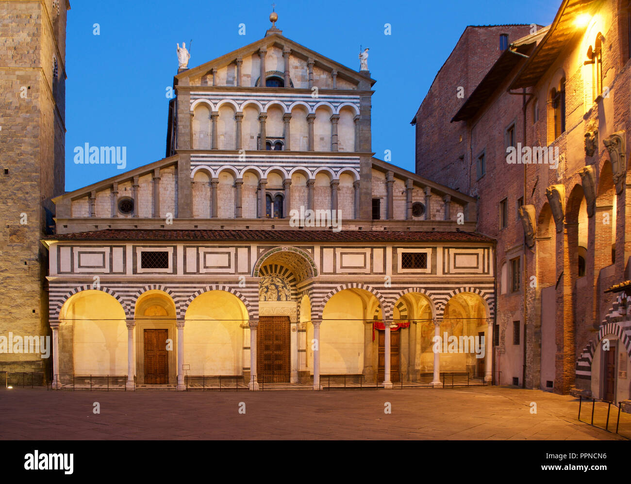 Pistoia central square (Piazza duomo) Cathedral facade during blue hour with soft golden light - Stock Image