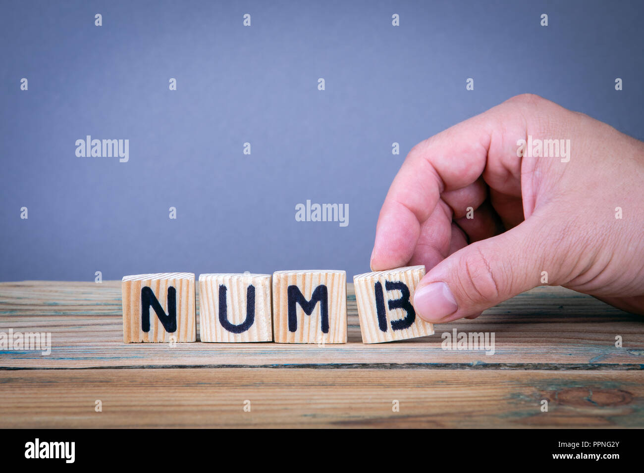 numb. Wooden letters on the office desk - Stock Image