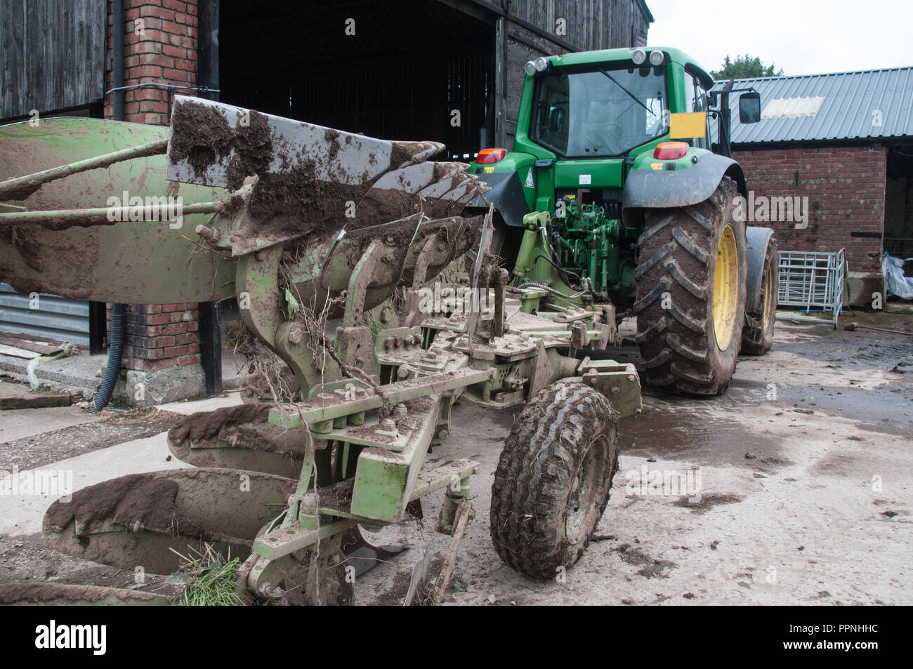 Tractor with plough attachment Stock Photo