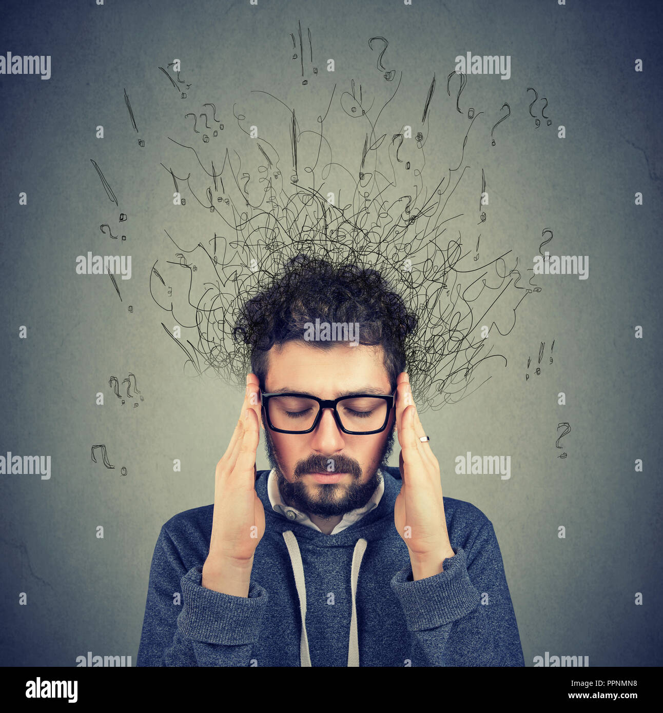 Closeup sad young man with worried stressed face expression and brain melting into lines question marks. Obsessive compulsive, adhd, anxiety disorders - Stock Image