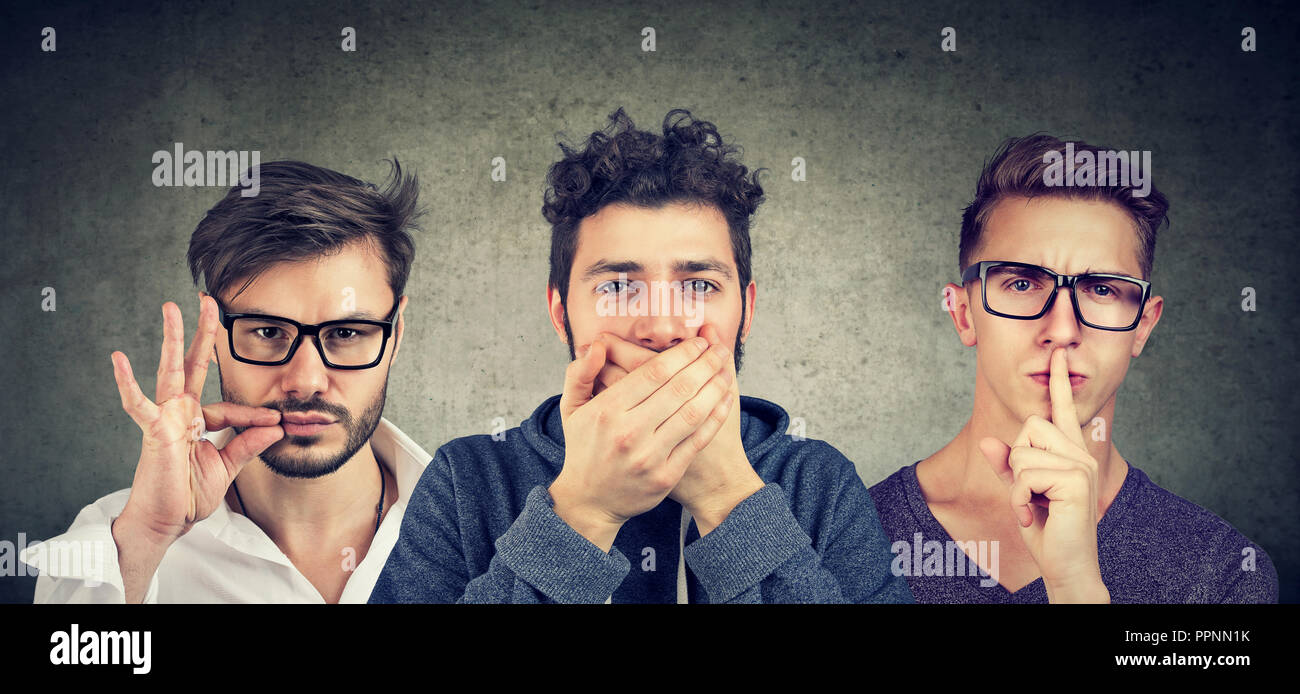 Keep a secret be quiet concept. Three secretive men keeping mouth shut. - Stock Image