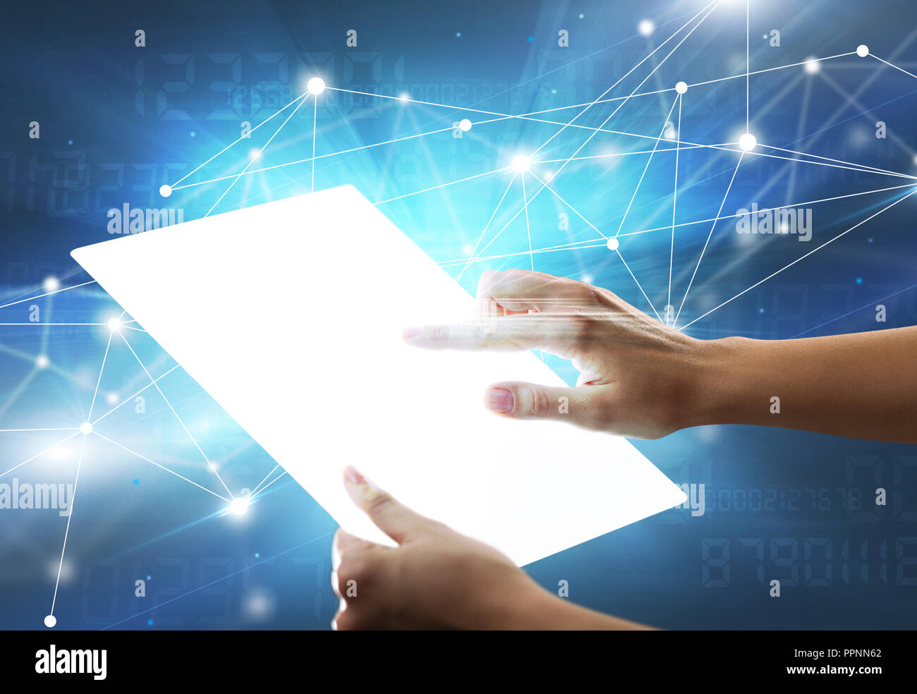 Young female hand holding a tablet with numbers in the background - Stock Image
