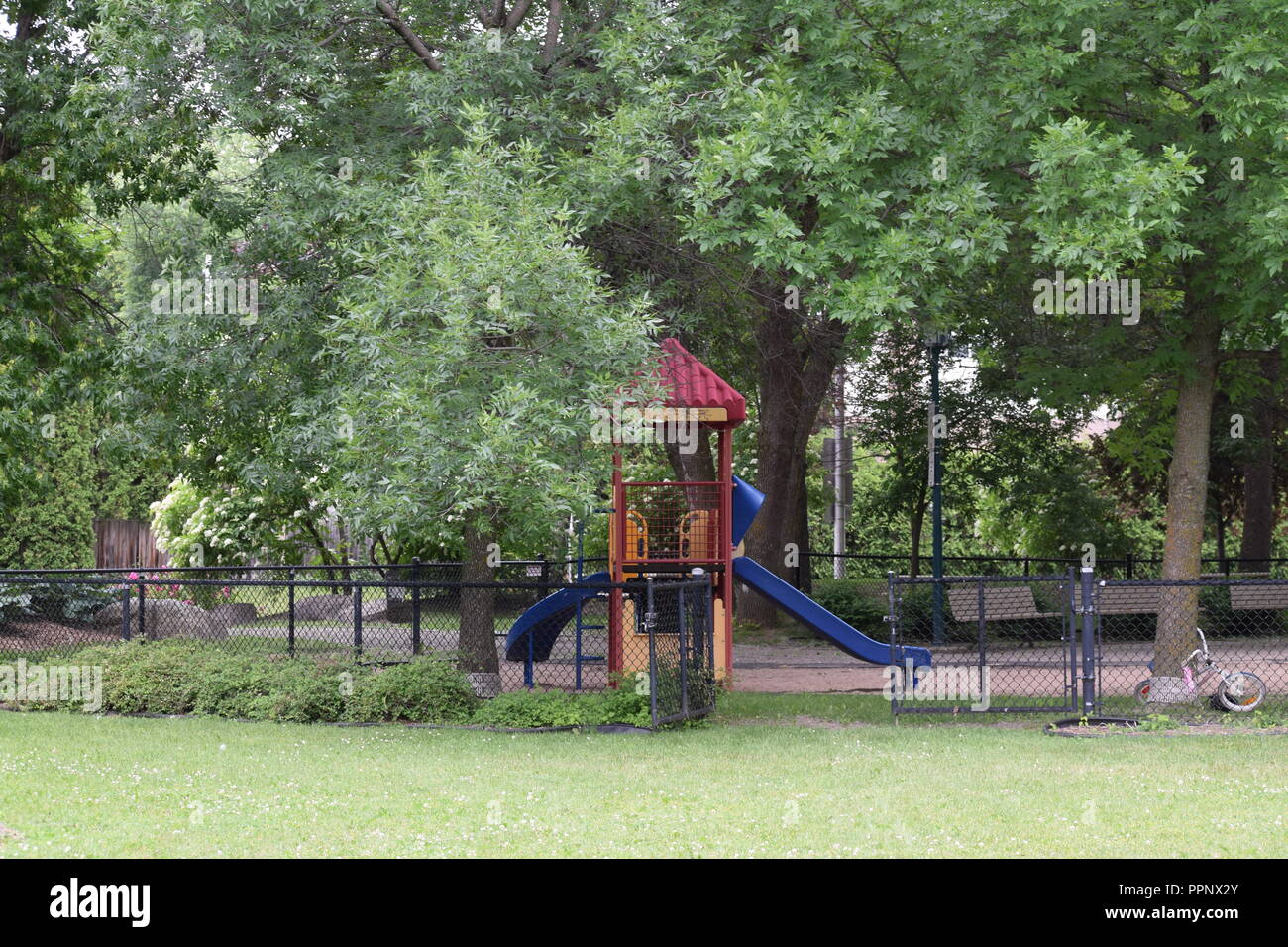 Deserted playground in Montreal Canada during the summer of 2018 - Stock Image