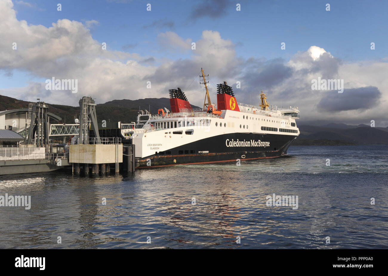 THE LOCH SEAFORTH CALEDONIAN MACBRAYNE FERRY DOCKING AT ULLAPOOL SCOTLAND RE FERRIES ISLANDS TOURISM TOURISTS SCOTTISH ISLAND HOPPING HEBRIDES UK - Stock Image