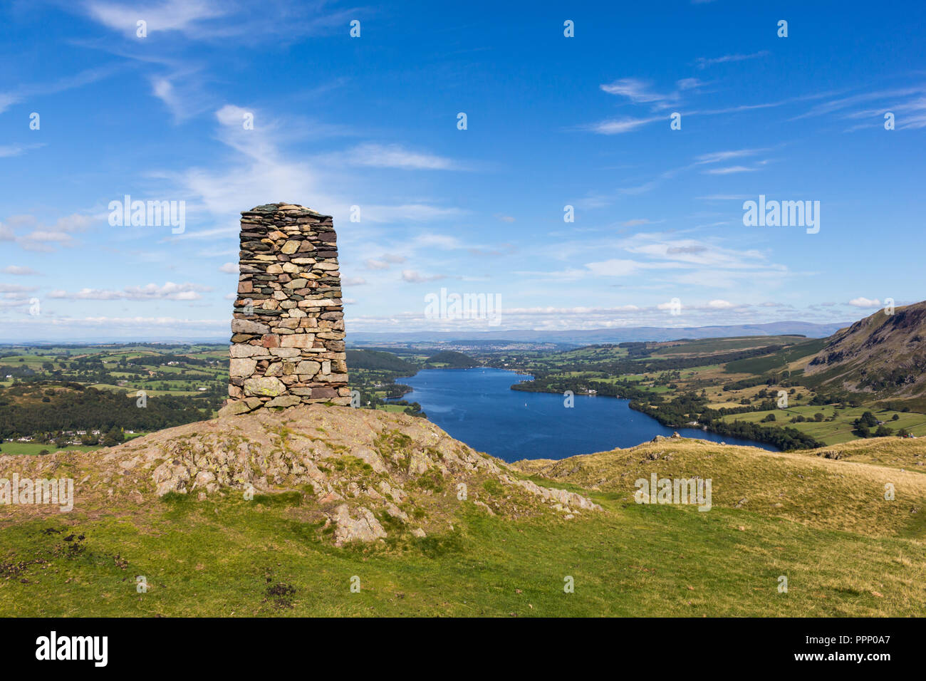 Large stone cairn on the summit of Hallin Fell overlooking Ullswater in the Lake District, England. Stock Photo