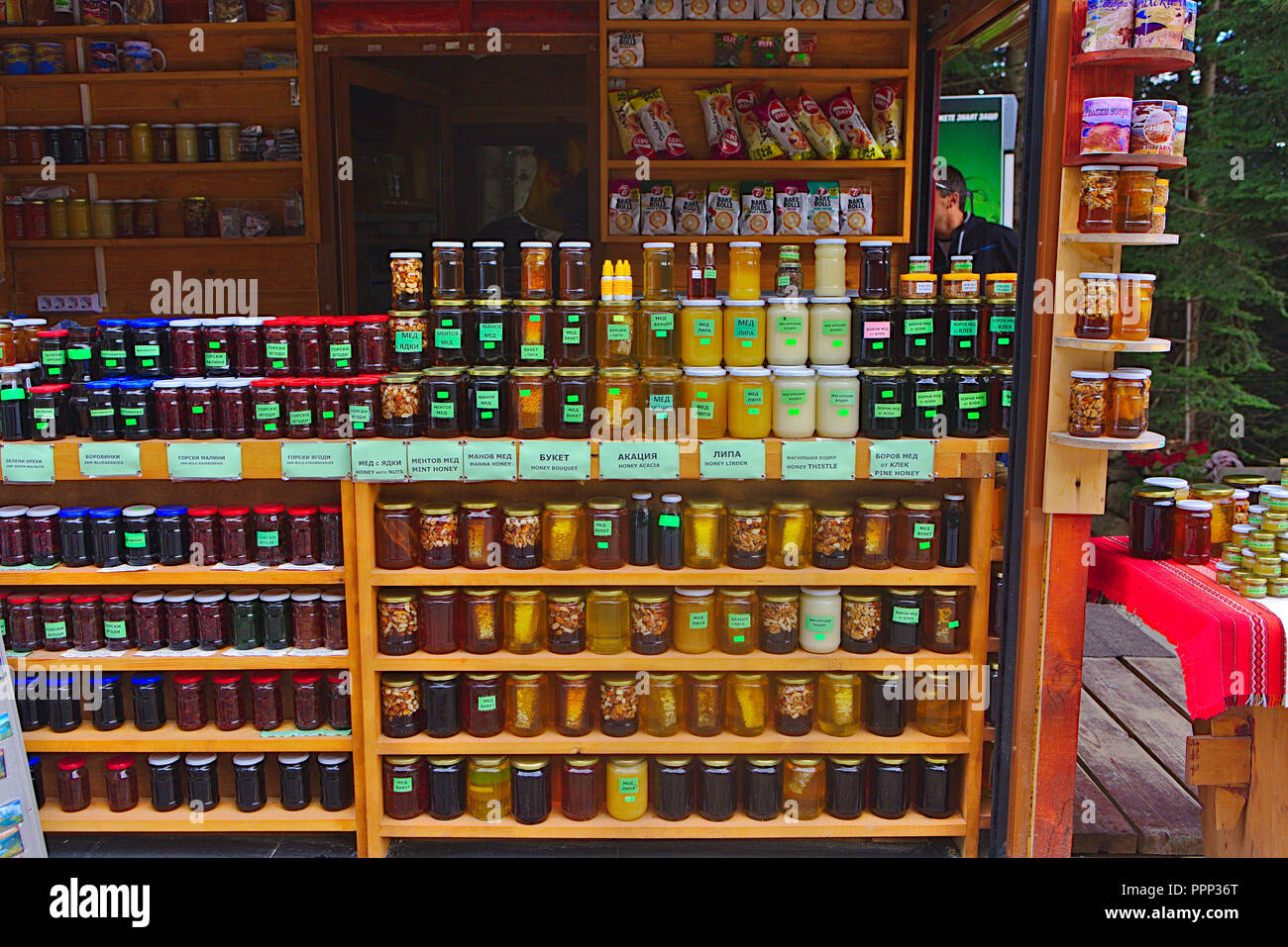 shelves of local produce at a stall in the mountains of rila - Stock Image