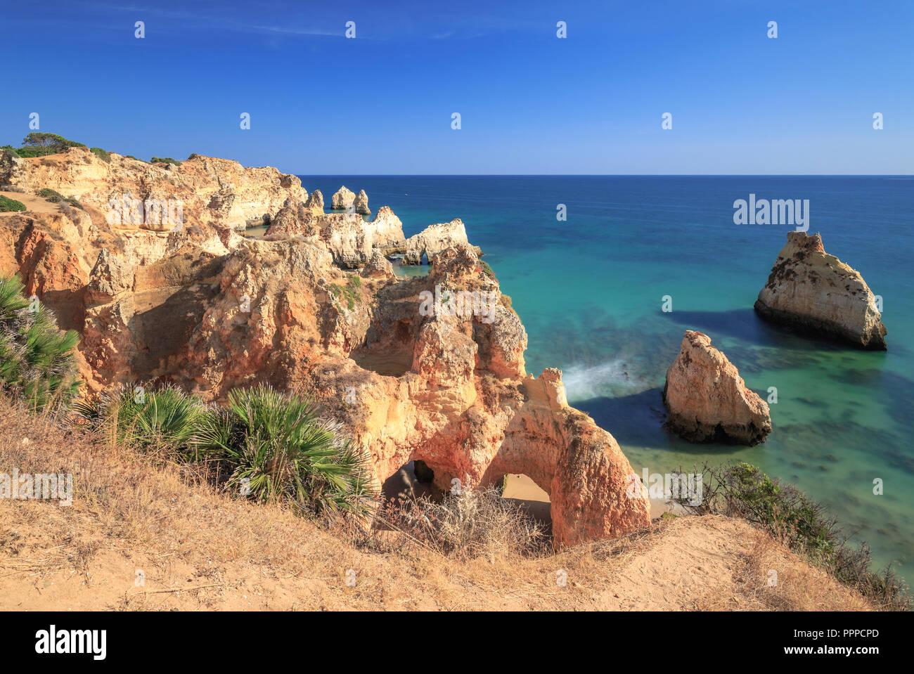 Rocks on the beach Praia dos tres Irmaos at the Algarve coast between Alvor and Portimao near Lagos - Stock Image