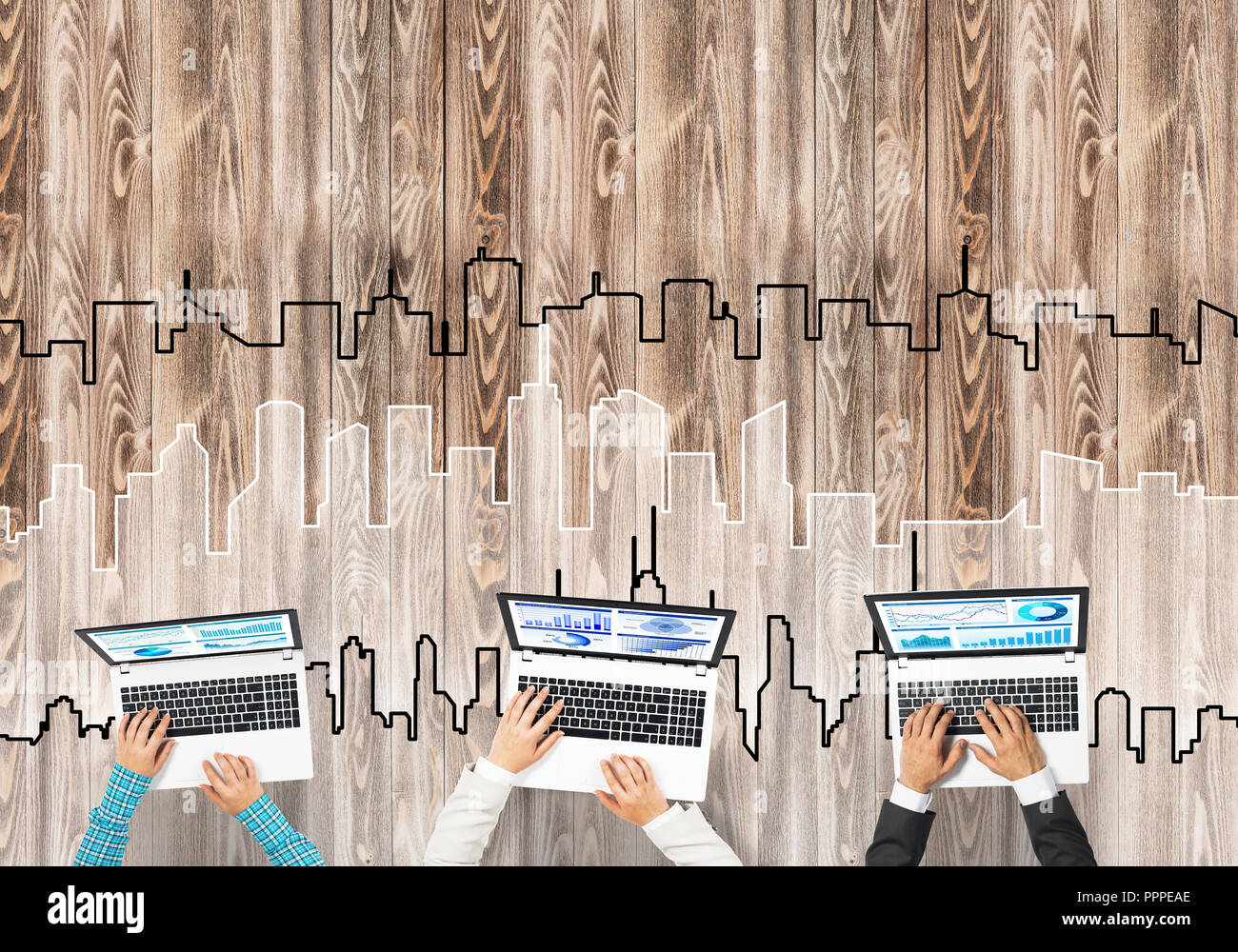 Top view of businesspeople sitting at table and using gadgets - Stock Image