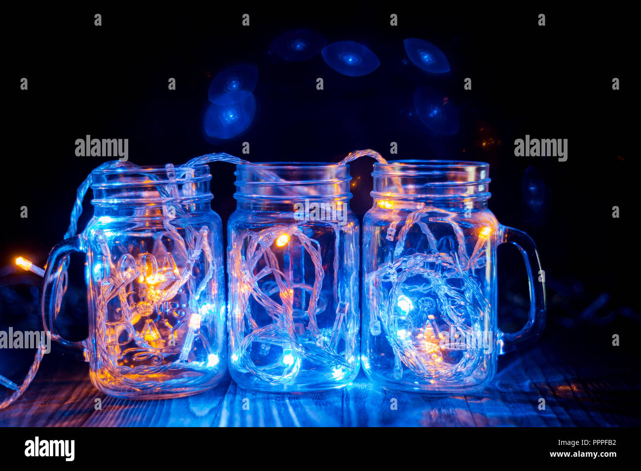 Colorful Lights In A Glass Transparent Jars Christmas Lights In The