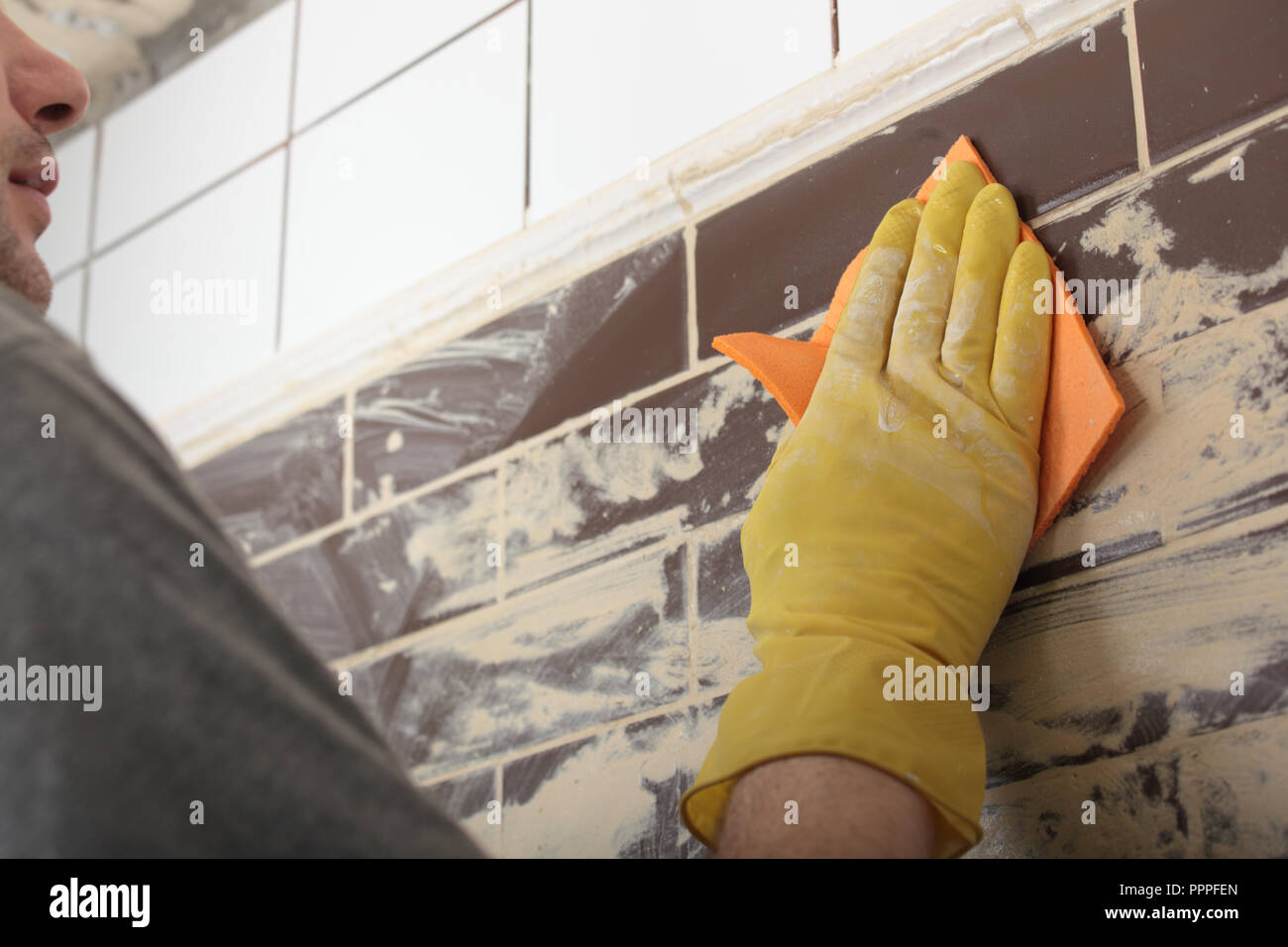 Contractor Grouting Ceramic Tiles On A Wall Stock Photo 220541965