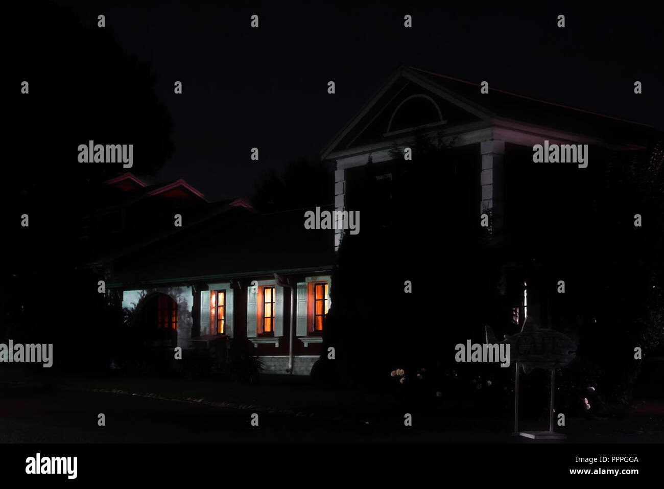 The light in the Windows of a country house. Night, summer, village Stock Photo