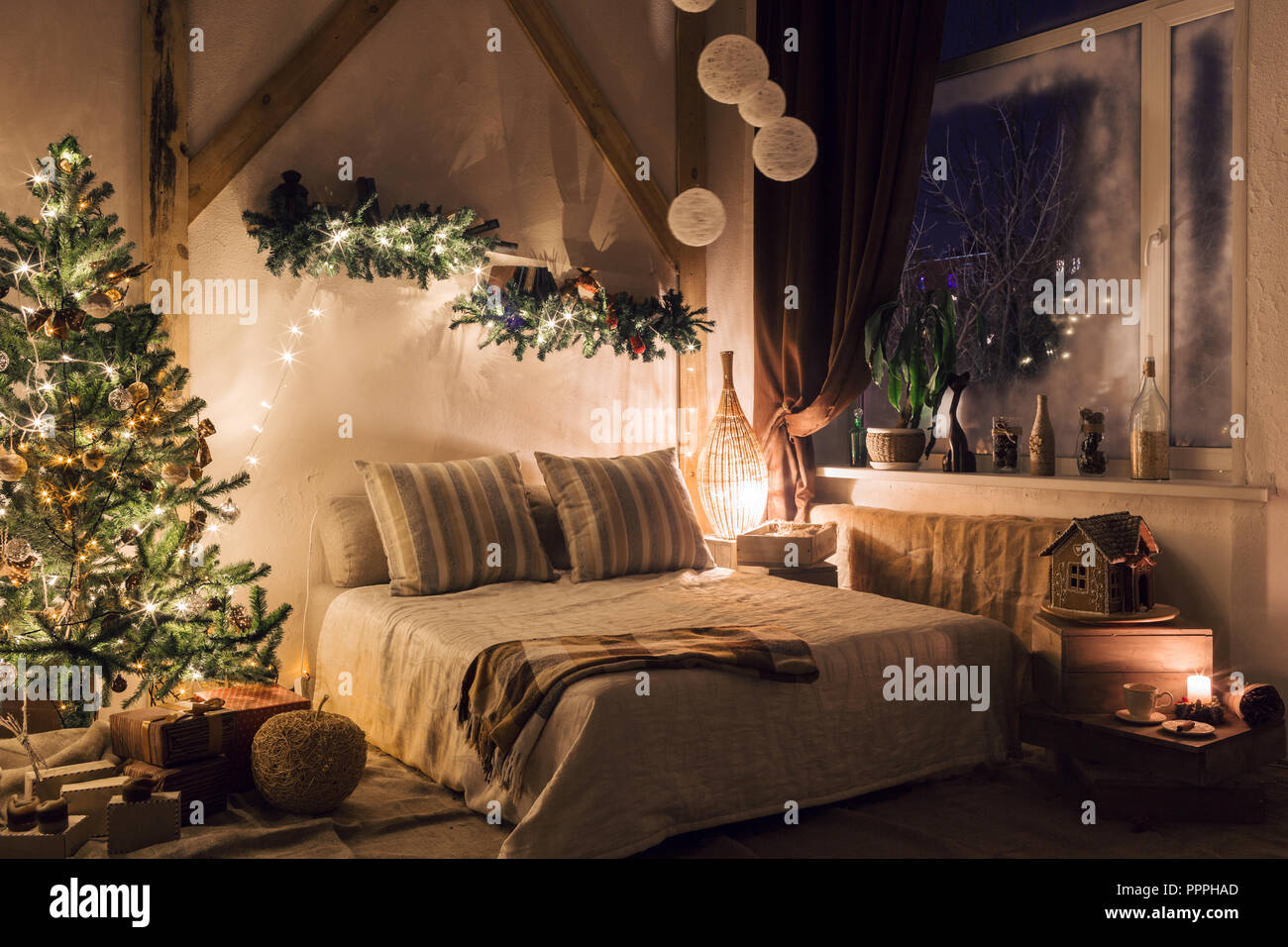 warm and cozy evening in living room. Sofa bed In christmas Interior. concept the new year and holidays. Stock Photo