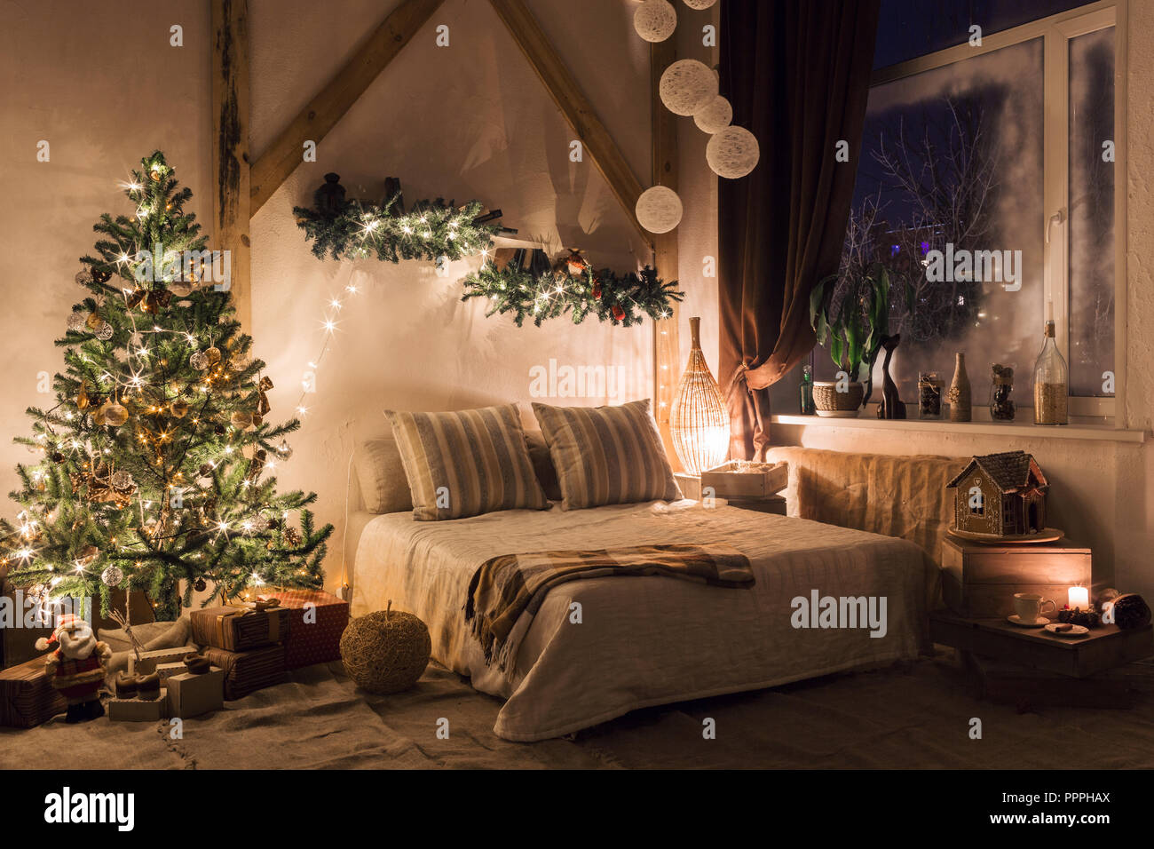 warm and cozy evening in living room. Sofa bed In christmas Interior. concept the new year and holidays. - Stock Image