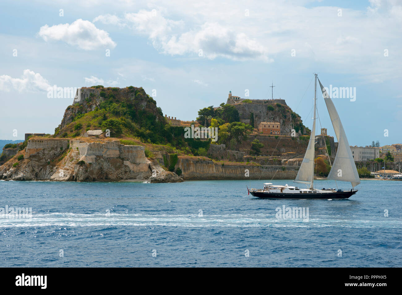 Sailboat and view to old fortress, Corfu, Corfu, Greece - Stock Image