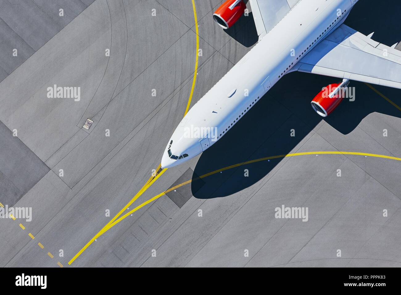 Aerial view of airport. Airplane taxiing to runway before take off. - Stock Image