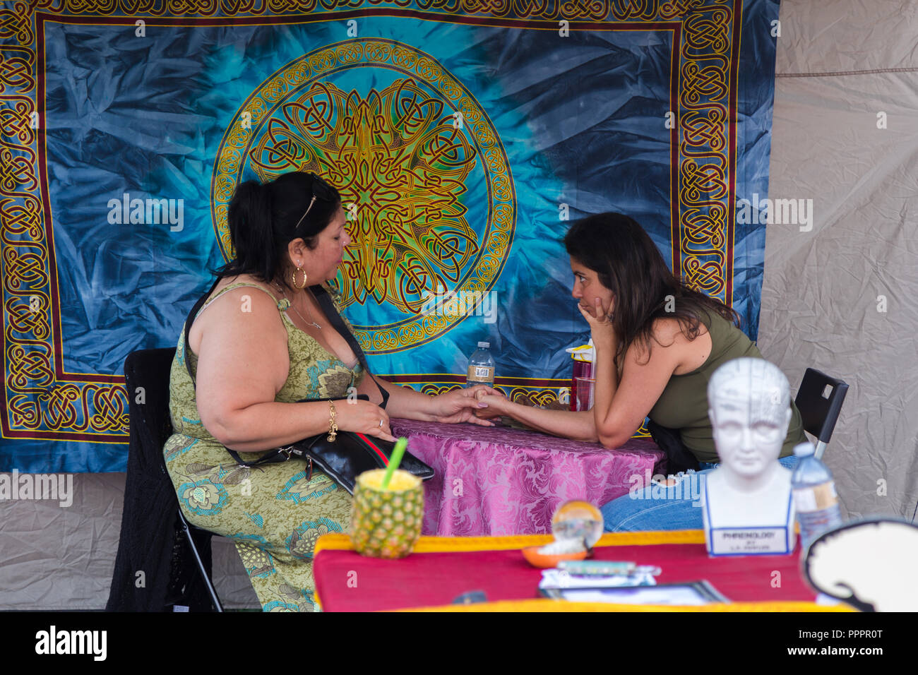 TORONTO, ON, CANADA - JULY 29, 2018: A fortune teller with a client at Kensington market in Toronto. - Stock Image