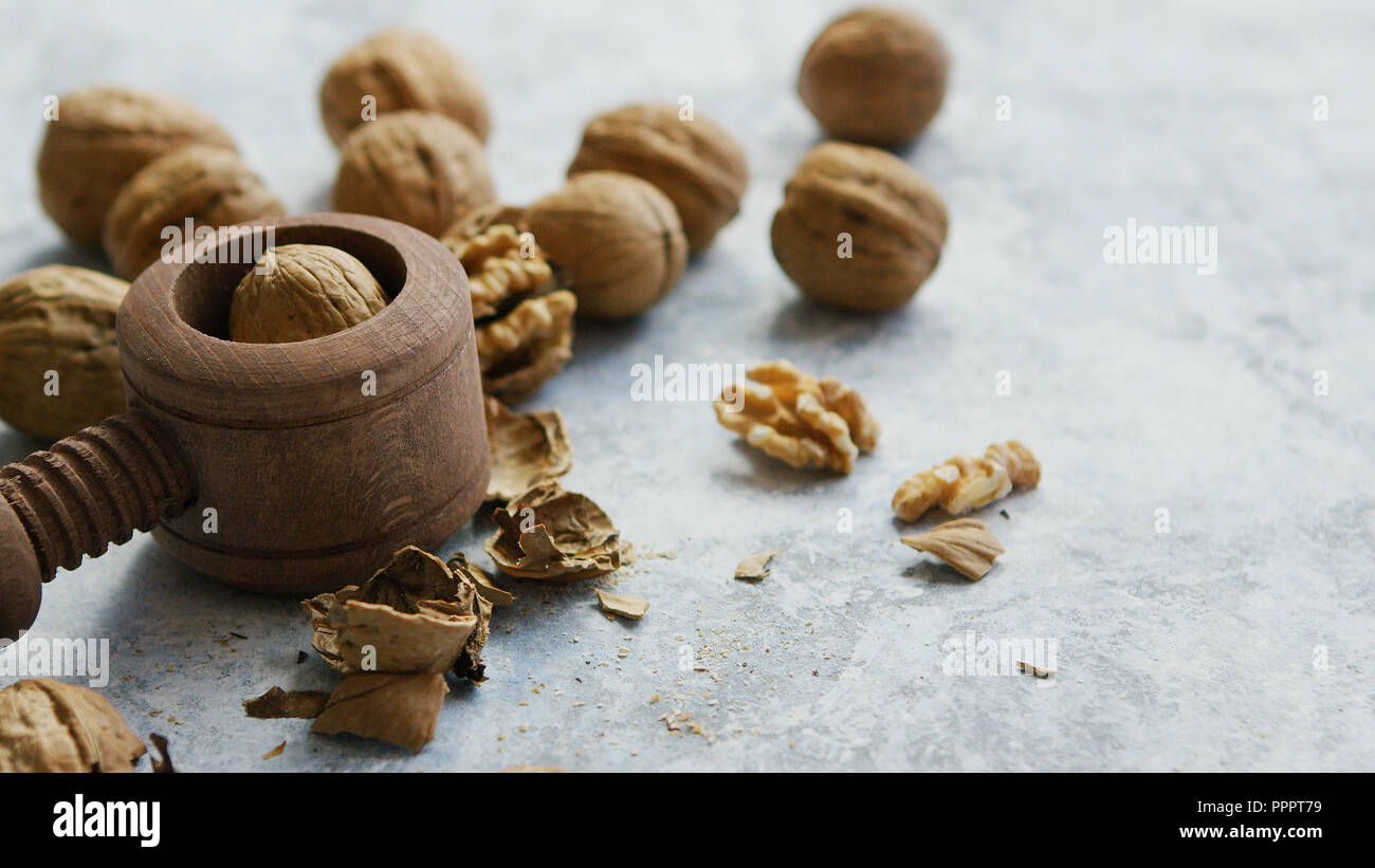 Walnuts in shells and cracker - Stock Image