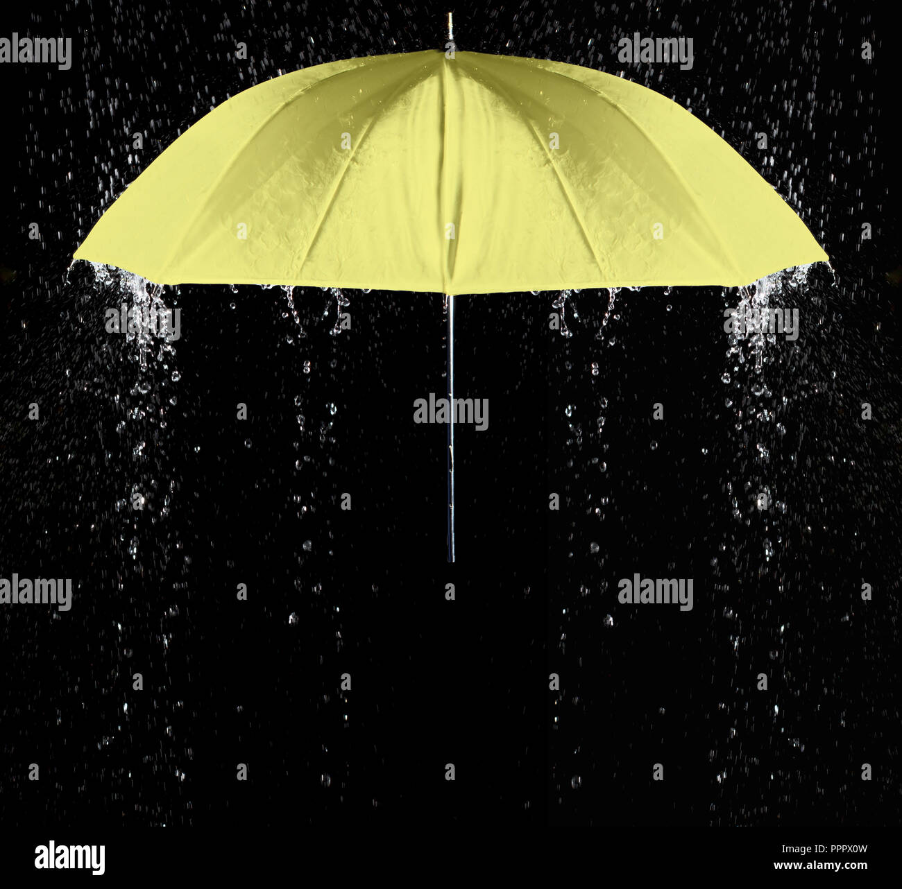 Yellow umbrella under raindrops with black background. Business and fashion concept. Stock Photo