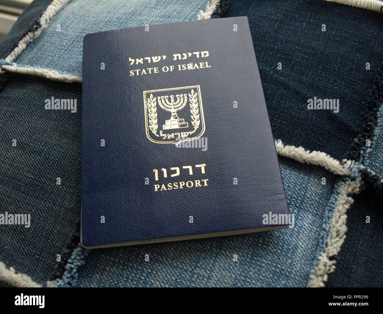 Passport of israel citizen. Israeli blue passport - Darkon on denim Stock Photo
