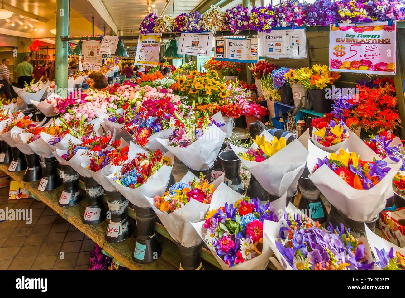Flower Stand Inside Pike Place Market In Seattle Washington