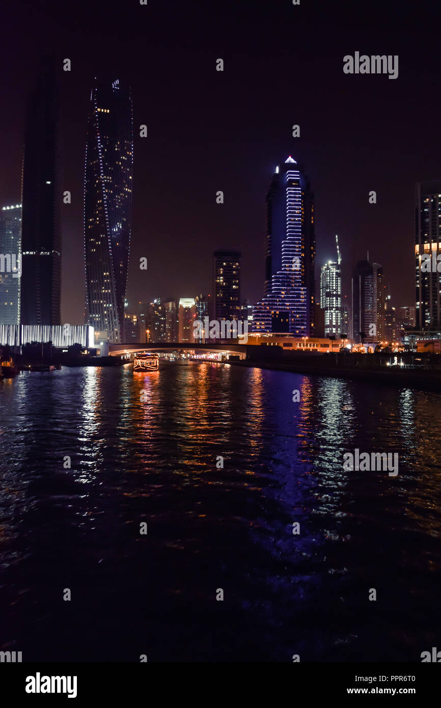 DUBAI, UNITED ARAB EMIRATES - UAE - Asia 23 APRIL 2016: Skyscrapers of City Marina at night. Panoramic skyline view lights and reflections. Famous for - Stock Image