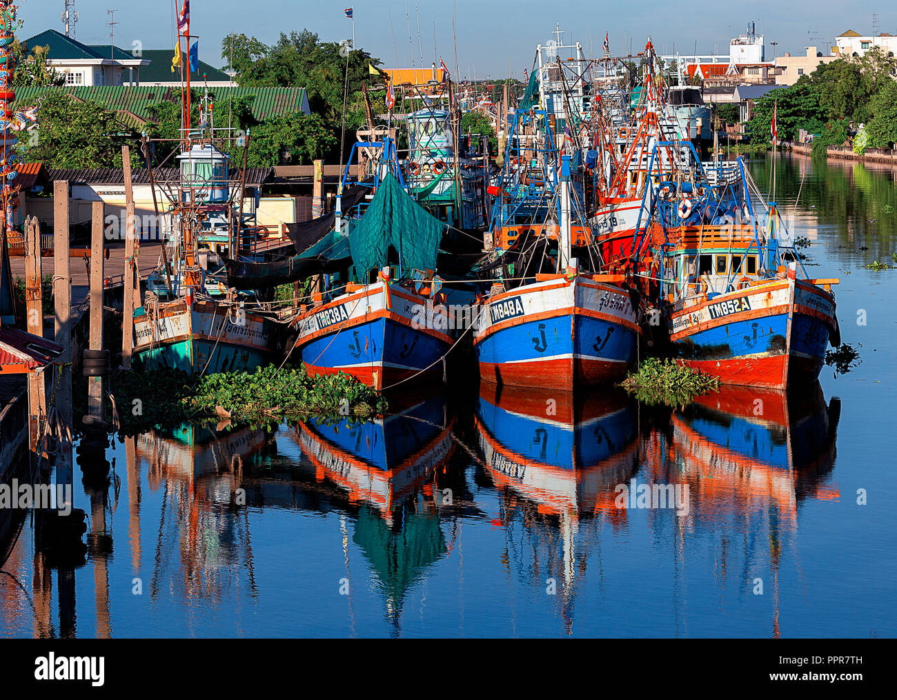 fishing boats in a harbor in Thailand Stock Photo
