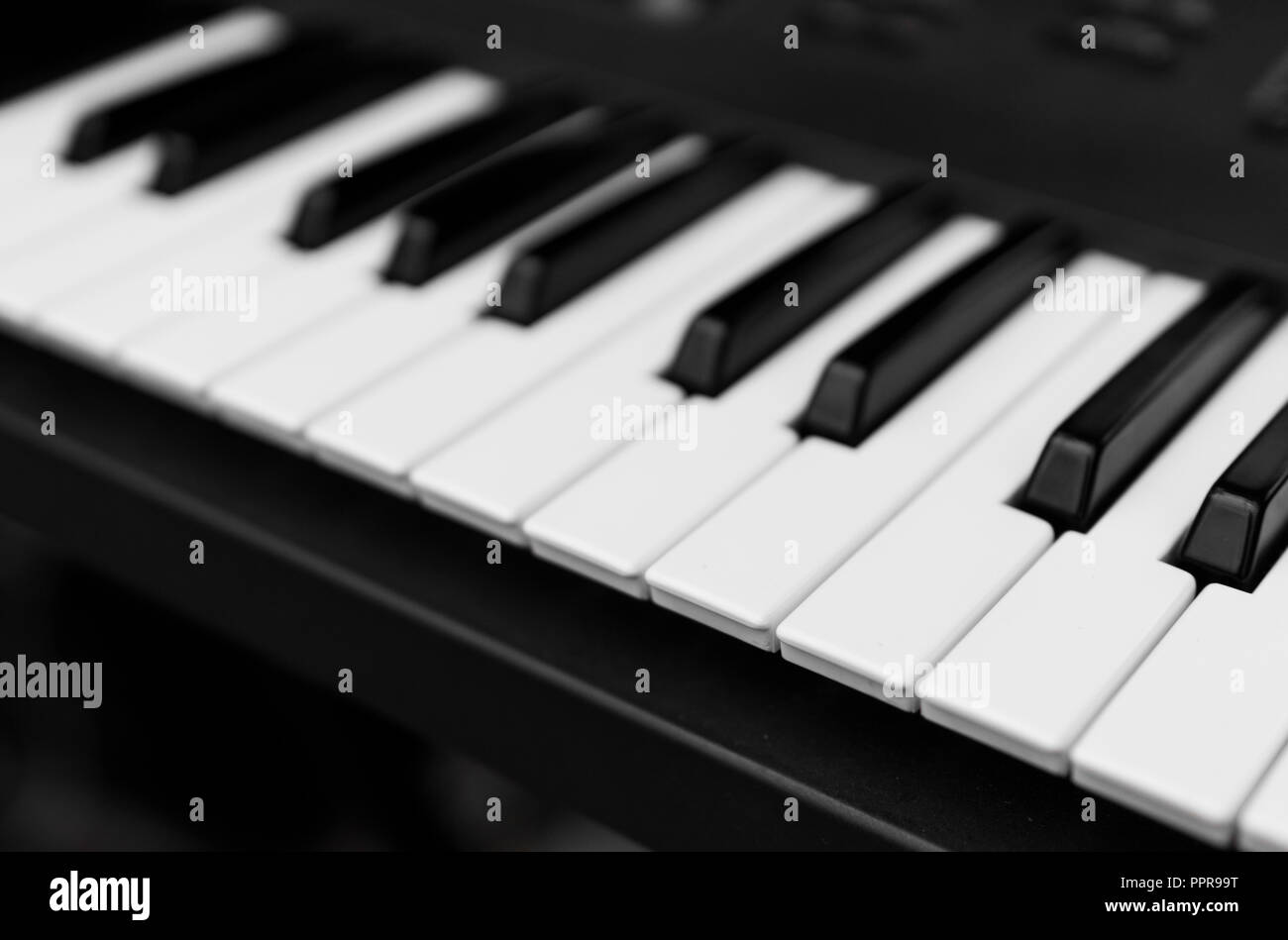 Synthesizer piano key board top view.Professional electronic midi keyboard with black and white keys. - Stock Image