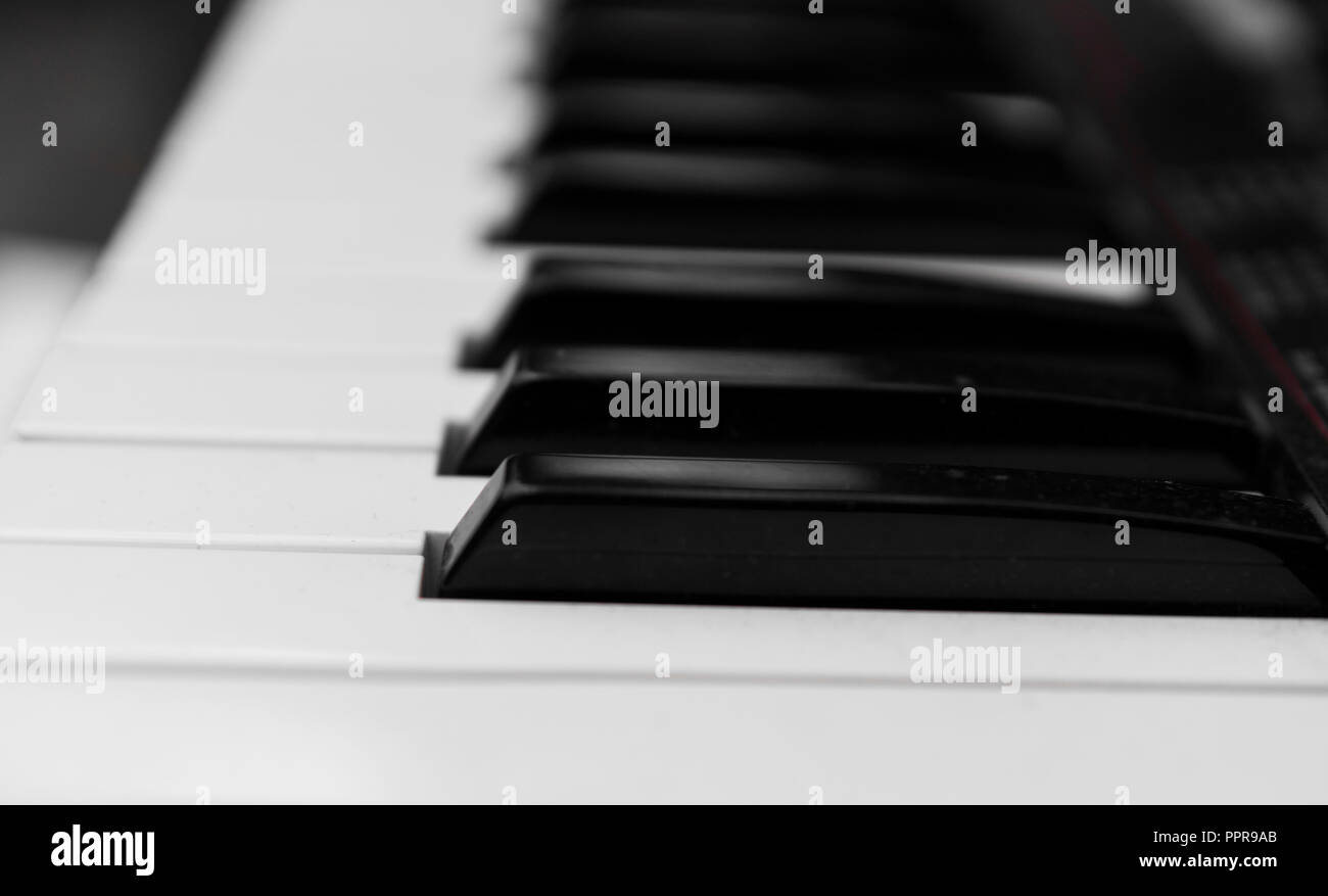 Synthesizer piano key board side view.Professional electronic midi keyboard with black and white keys. - Stock Image