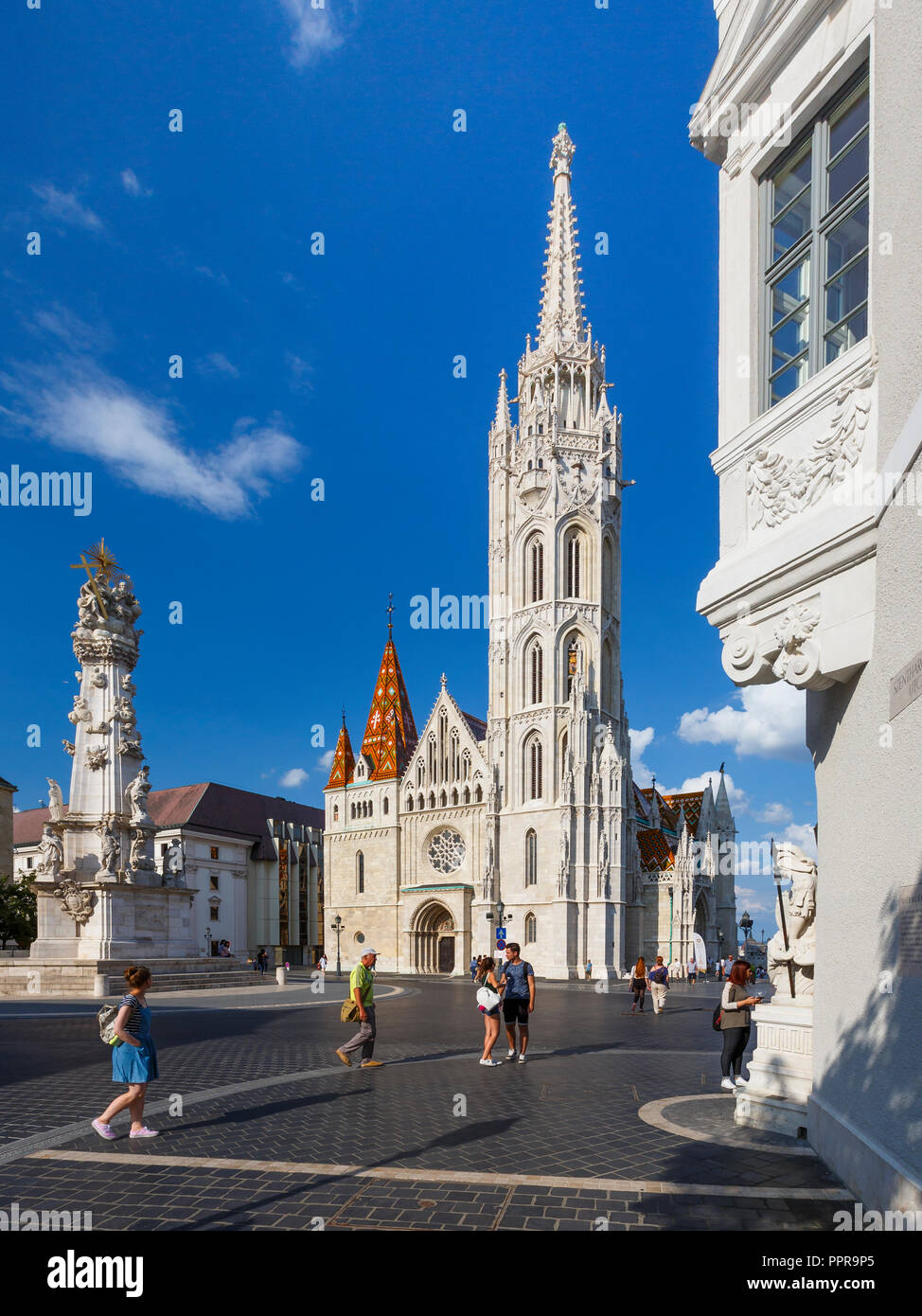 Budapest, Hungary - August 16, 2018: View of Trinity column and Matthias church in historic city centre of Budapest, Hungary. - Stock Image