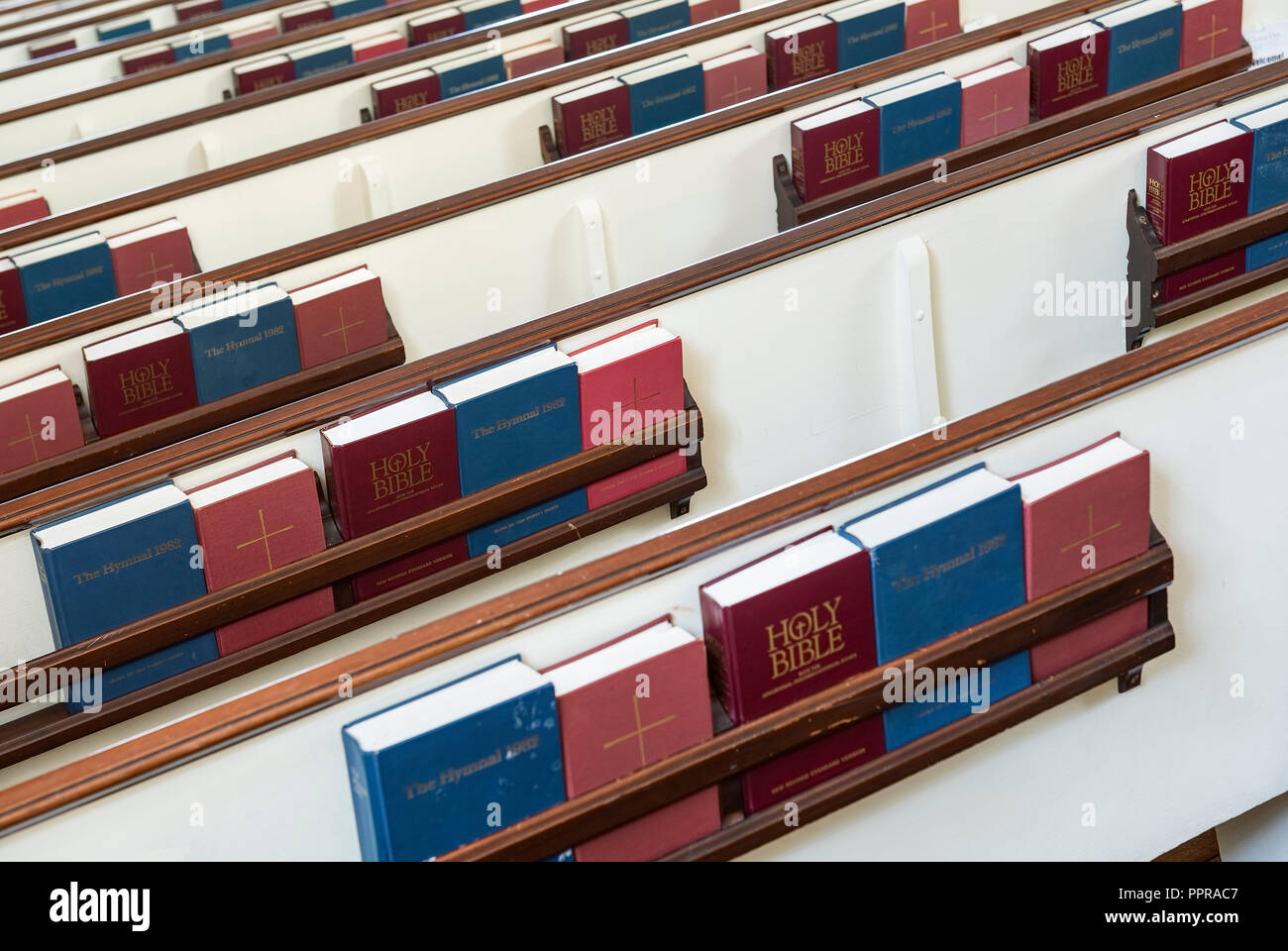 Church pews with prayerbooks and hymnals. Stock Photo