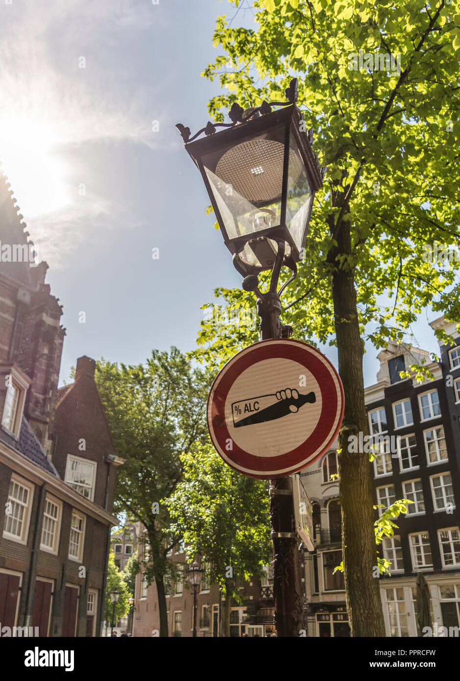 Alcohol prohibition sign on the vintage street lamp in Amsterdam city, Netherlands. The sign prohibits drinking alcohol beverages on the street. - Stock Image