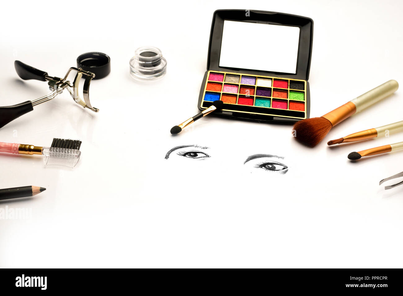 Eye shadow palette and make-up brush on white background