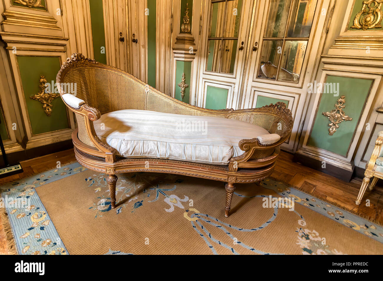 Queluz, Portugal - December 9, 2017: Divan inside of rich decorated Queluz Royal Palace. Formerly used as the Summer residence by the Portuguese royal Stock Photo