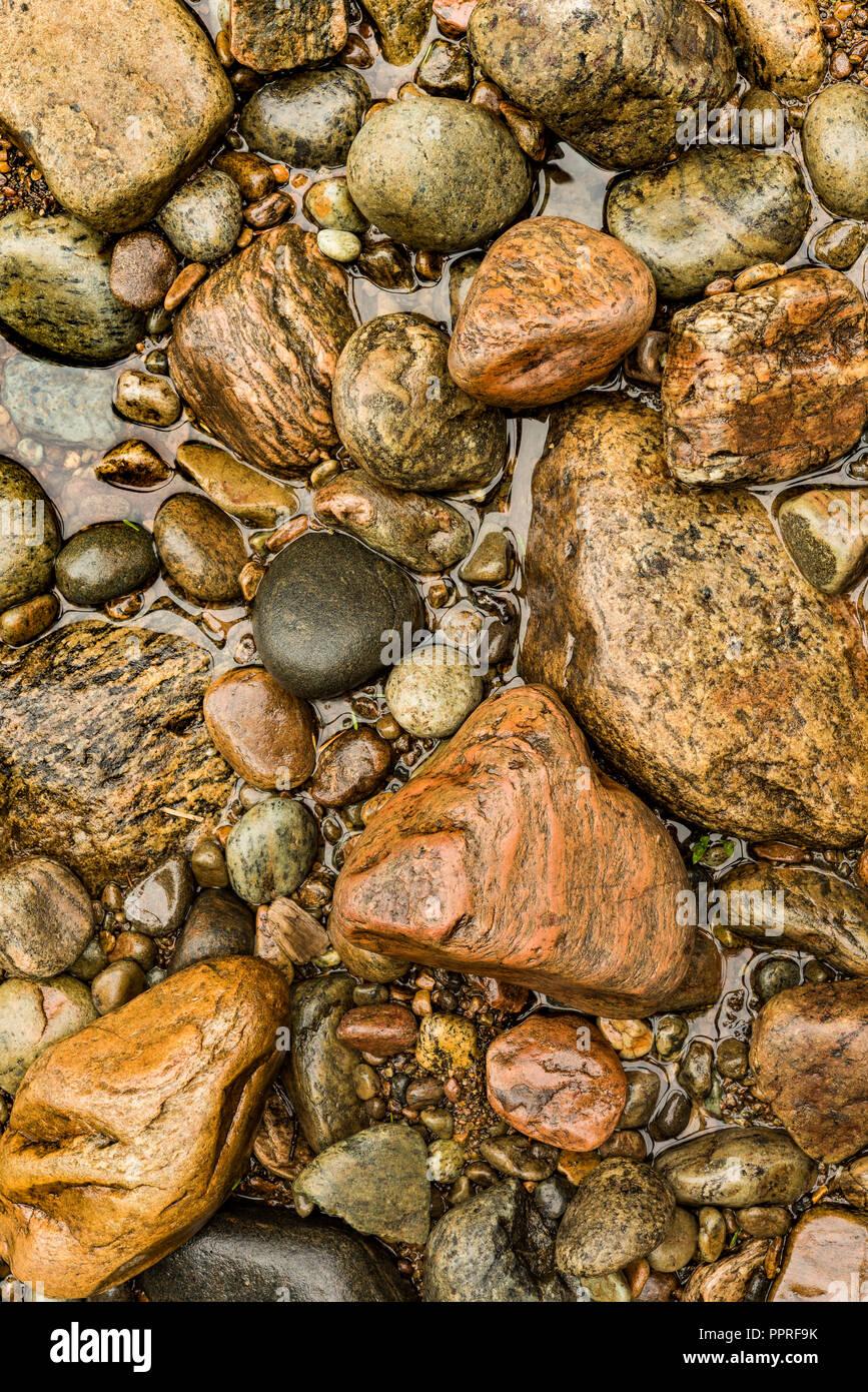 Rocks along the bank of Sacandaga River, Adirondack Mountains, Hamilton Co., NY - Stock Image
