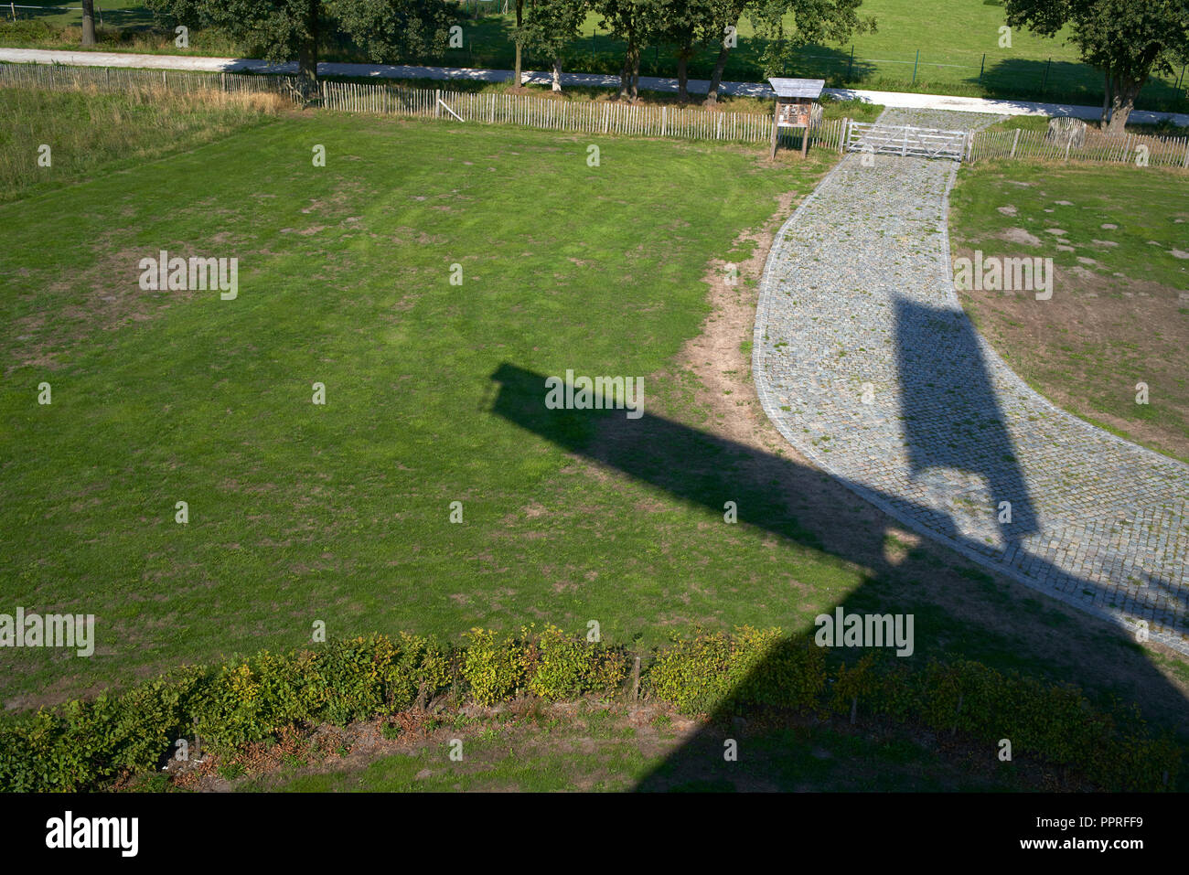 shadow of old wooden windmill in Lommel, Belgium - Stock Image