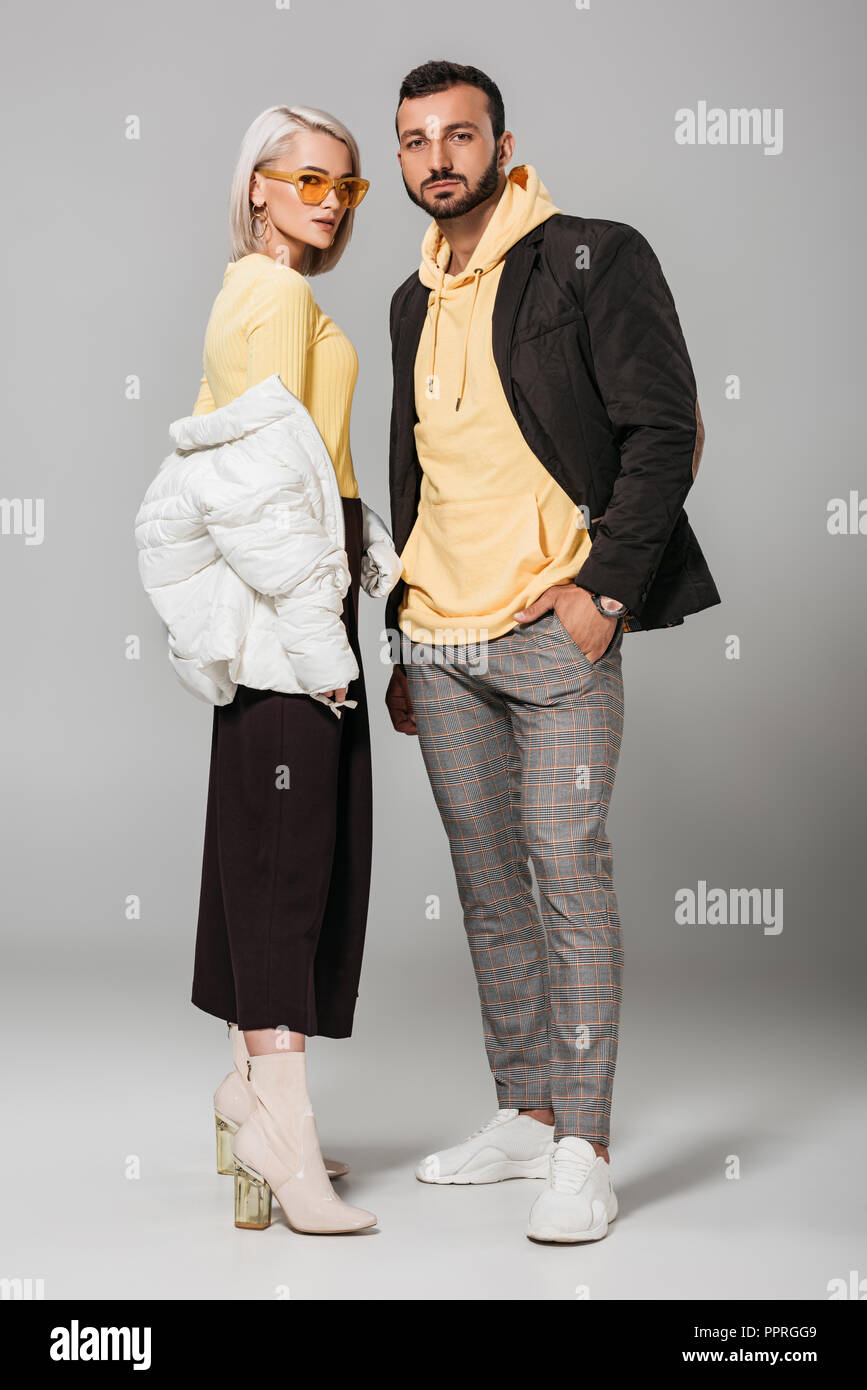 Young Couple Of Models In Stylish Autumn Outfits Posing On Grey Background Stock Photo Alamy