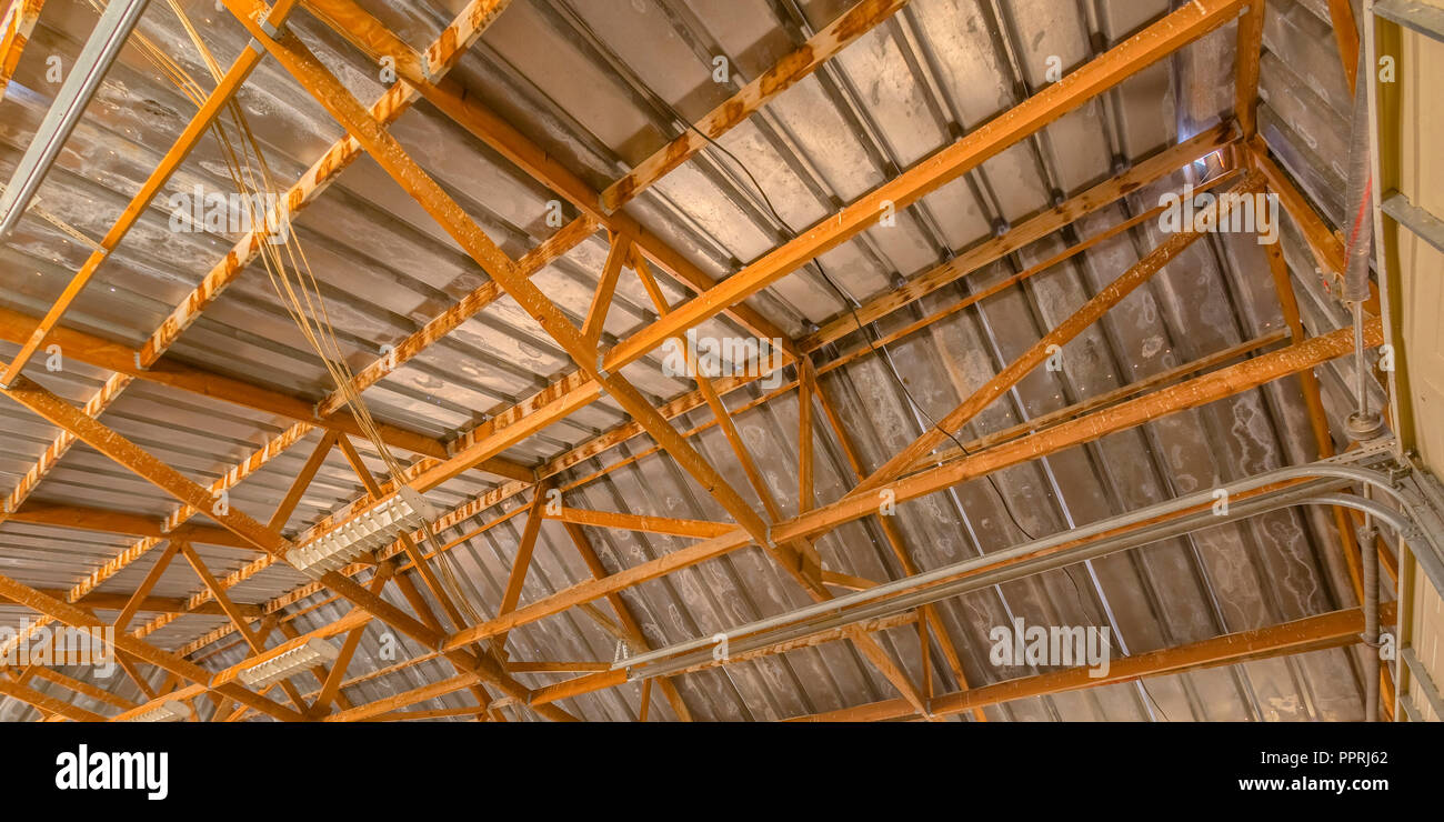 Close up view of a barn interior roof framework - Stock Image