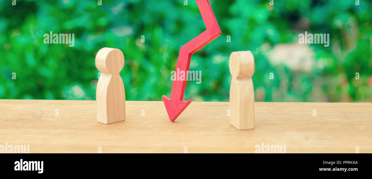 Two people are separated by a red arrow. The concept of conflict and discord, disagreement and misunderstanding of the opponent. A controversial issue - Stock Image